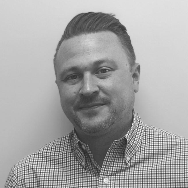Corporate headshot of Will Darcey